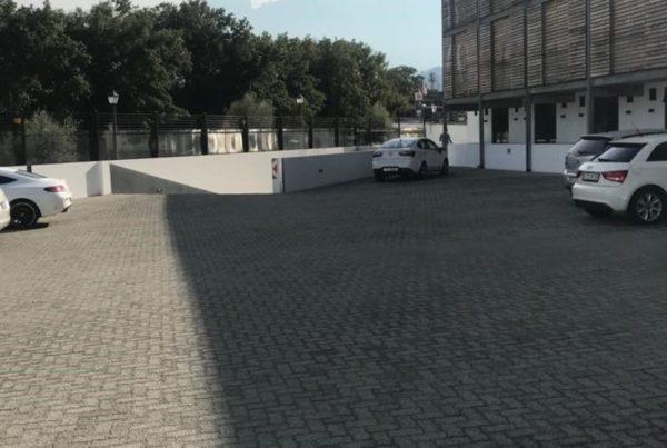 cars parked parking lot building